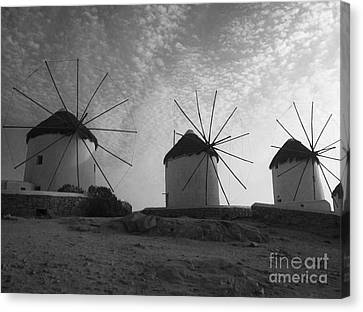 Mykonos Windmills Canvas Print by Leslie Leda