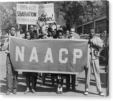 Naacp Banner Is Held By Protesters Canvas Print by Everett