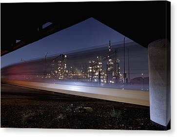 Oil Refinery And Train Blur Canvas Print by Mike Raabe