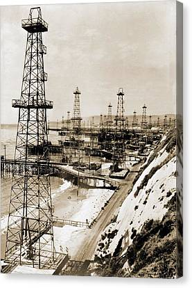 Oil Well Derricks On The Beach Canvas Print by Everett