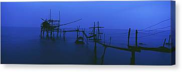Old Fishing Platform Over Water At Dusk Canvas Print by Axiom Photographic
