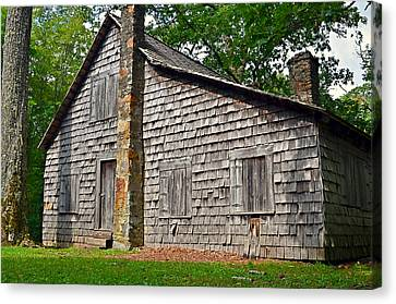 Old Home In Forest Canvas Print by Susan Leggett