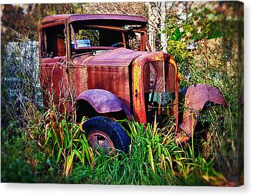 Old Rusting Truck Canvas Print by Garry Gay
