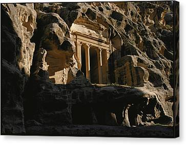 One Of The Many Tombs Carved Canvas Print by Annie Griffiths