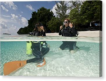 Open Water Student Diver, Mataking Canvas Print by Mathieu Meur