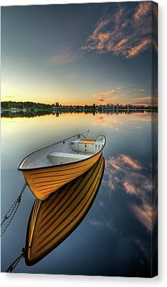 Orange Boat With Strong Reflection Canvas Print by David Olsson