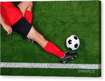 Overhead Football Player Sliding Canvas Print by Richard Thomas