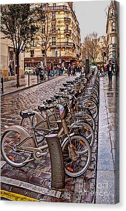 Paris Wheels For Rent Canvas Print by Bob and Nancy Kendrick