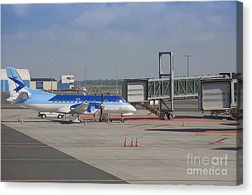 Parked Airplane At An Airport Gate Canvas Print by Jaak Nilson