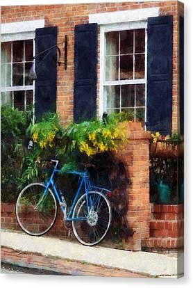 Parked Bicycle Canvas Print by Susan Savad