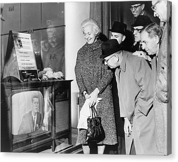 People Gather Around A Television Canvas Print by Everett