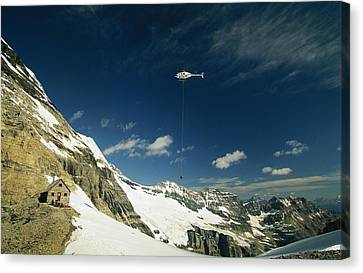 Person Dangles From A Helicopter Canvas Print by Michael Melford
