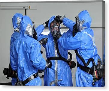 Personnel Dressed In Hazmat Suits Canvas Print by Stocktrek Images
