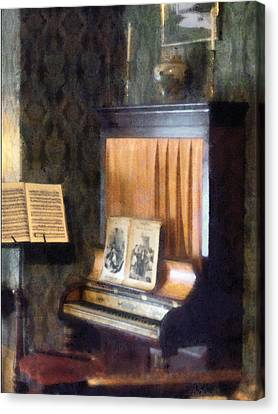 Piano And Sheet Music On Stand Canvas Print by Susan Savad