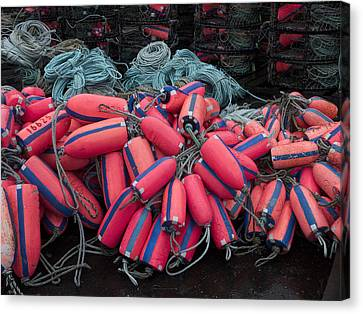 Pile Of Pink And Blue Buoys Canvas Print by Carol Leigh