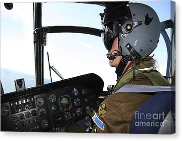 Pilot In The Cockpit Of A Ch-46 Sea Canvas Print by Daniel Karlsson
