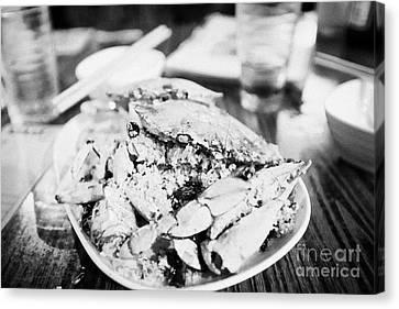 Plate Of Spicy Crab Seafood At A Table In An Outdoor Cafe At Night Kowloon Hong Kong Hksar China Canvas Print by Joe Fox