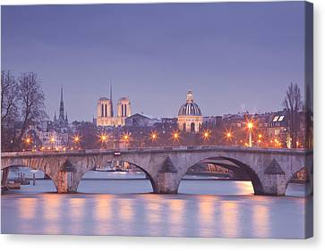 Pont Royal And The City Lights Of Paris Canvas Print by Julian Elliott Ethereal Light