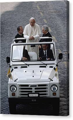 Pope John Paul II Rides In An Open-air Canvas Print by James L. Stanfield