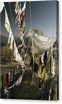 Prayer Flags Hang In The Breeze Canvas Print by Gordon Wiltsie