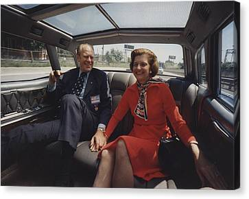 President And Betty Ford Hold Hands Canvas Print by Everett