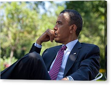 President Barack Obama Is Briefed Canvas Print by Everett