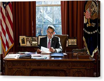 President Barack Obama Reviews Canvas Print by Everett