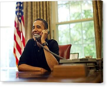 President Barack Obama Talks By Phone Canvas Print by Everett