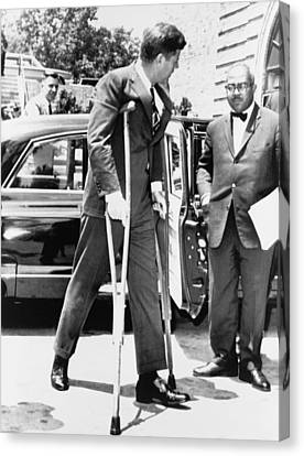 President John F. Kennedy On Crutches Canvas Print by Everett