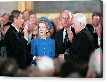 President Reagan Taking The Oath Canvas Print by Everett