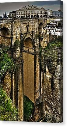 Puente Nuevo - Parador De Ronda Canvas Print by Juergen Weiss