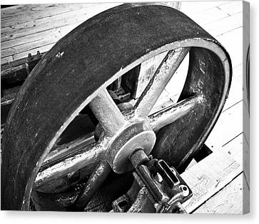 Pulley Wheel From Industrial Sawmill Canvas Print by Paul Velgos