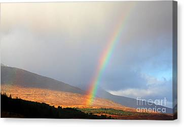 Rainbow In Scotland Canvas Print by Holger Ostwald