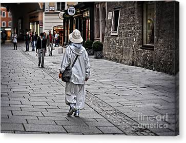 Rainwear In Salzburg Canvas Print by Mary Machare