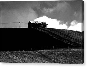 Ranch Building And Clouds Canvas Print by Noel Elliot