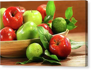 Red And Green Apples In A Bowl Canvas Print by Sandra Cunningham