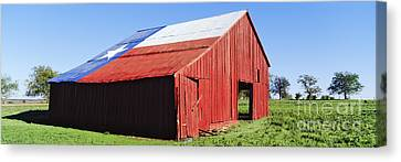 Red Barn In Field With Texas Flag On Roof Canvas Print by Jeremy Woodhouse