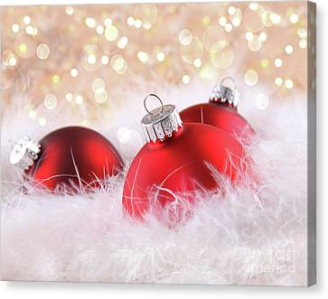 Red Christmas Balls With Abstract Background Canvas Print by Sandra Cunningham