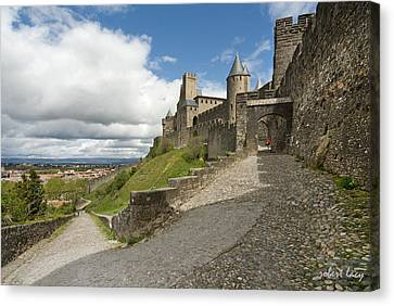 Red Jacket In Carcassonne Canvas Print by Robert Lacy
