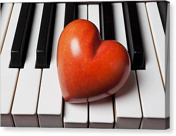 Red Stone Heart On Piano Keys Canvas Print by Garry Gay