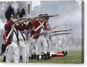 Redcoats Shoot Muskets In A Reenactment Canvas Print by Ira Block