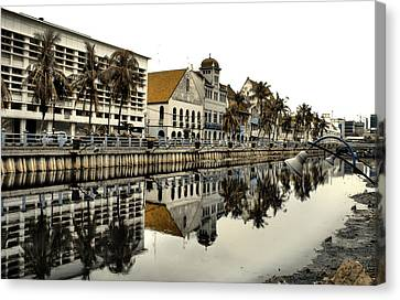 Reflection Of Old Buildings Canvas Print by Aris and Ressy