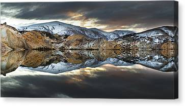 Reflections Of Cliffs On Blue Lake St Bathans Canvas Print by Colin Monteath