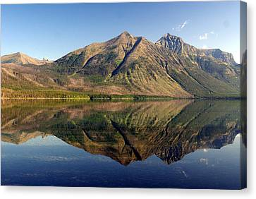 Reflections On Lake Mcdonald Canvas Print by Marty Koch