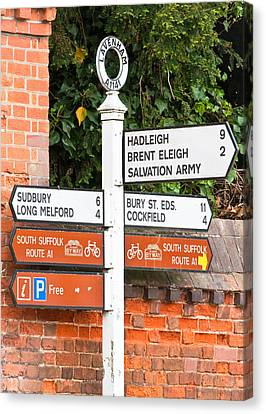 Road Signs Canvas Print by Tom Gowanlock