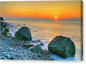 Rocky Shoreline At Sunset Canvas Print by Kurosaki San