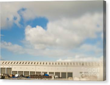 Rolling Doors Of A Warehouse Canvas Print by Eddy Joaquim