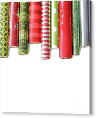 Rolls Of Colored Wrapping  Paper On White3 Canvas Print by Sandra Cunningham