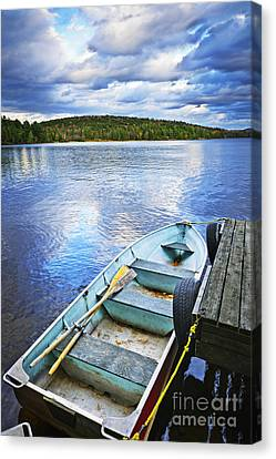 Rowboat Docked On Lake Canvas Print by Elena Elisseeva