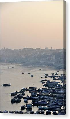 Rowing Boats On Ganges River Canvas Print by Jessica Solomatenko